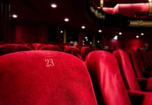 A close-up of empty movie theatre seats. You can access movie ticket discounts with your Seniors Card