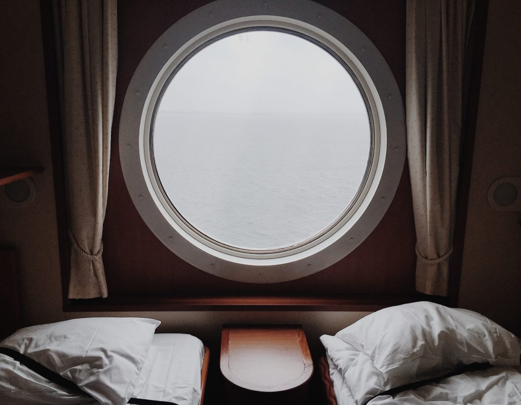 A view out a window of a cruise ship cabin.